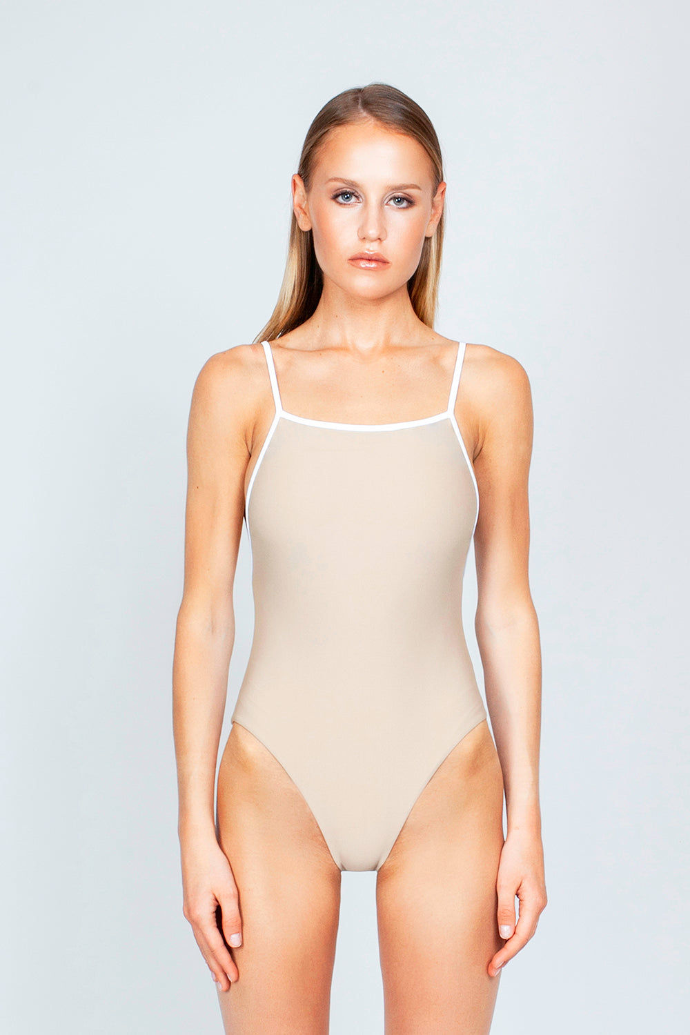 THE ONES WHO Margot High-Cut One Piece Swimsuit - Taupe Tan/White One Piece | Taupe Tan/White| The Ones Who Margot High Cut One Piece Swimsuit - Taupe Tan/White Features:   Square neckline  Adjustable shoulder straps High cut leg  Cheeky - moderate coverage  Made in LA  Fabric: 80% Nylon 20% Elastane Front View