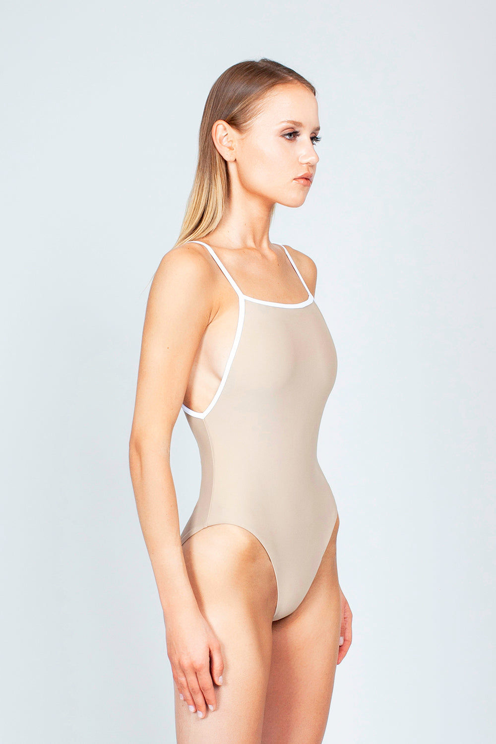 THE ONES WHO Margot High-Cut One Piece Swimsuit - Taupe Tan/White One Piece | Taupe Tan/White| The Ones Who Margot High Cut One Piece Swimsuit - Taupe Tan/White Features:   Square neckline  Adjustable shoulder straps High cut leg  Cheeky - moderate coverage  Made in LA  Fabric: 80% Nylon 20% Elastane Side View