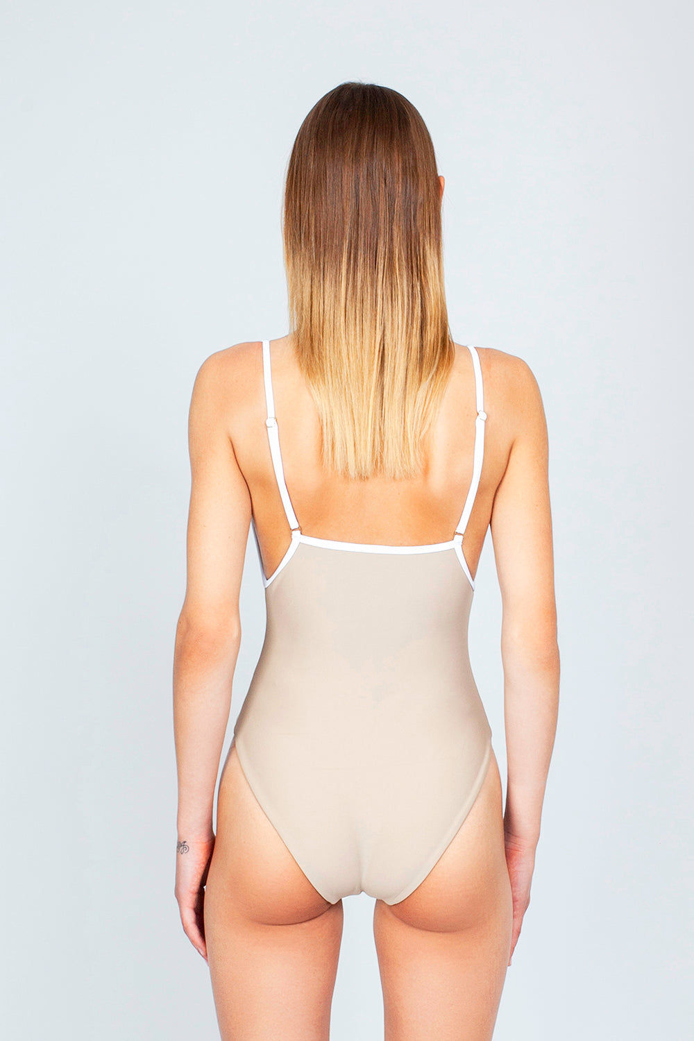 THE ONES WHO Margot High-Cut One Piece Swimsuit - Taupe Tan/White One Piece | Taupe Tan/White| The Ones Who Margot High Cut One Piece Swimsuit - Taupe Tan/White Features:   Square neckline  Adjustable shoulder straps High cut leg  Cheeky - moderate coverage  Made in LA  Fabric: 80% Nylon 20% Elastane Back View