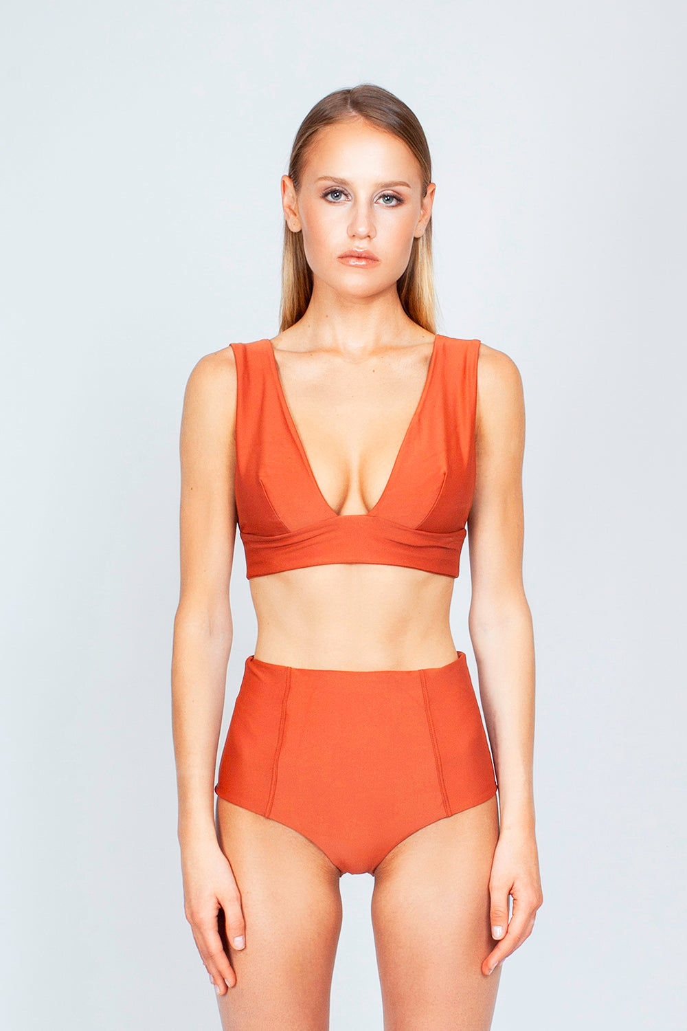 THE ONES WHO Dive Long Triangle Bikini Top - Copper Orange Bikini Top | Copper Orange| The Ones Who Dive Long Triangle Bikini Top - Copper Orange Long triangle top  V neckline  Thick bra band  V Back  Pull over  Made in LA  Fabric: 80% Nylon 20% Elastane Front View