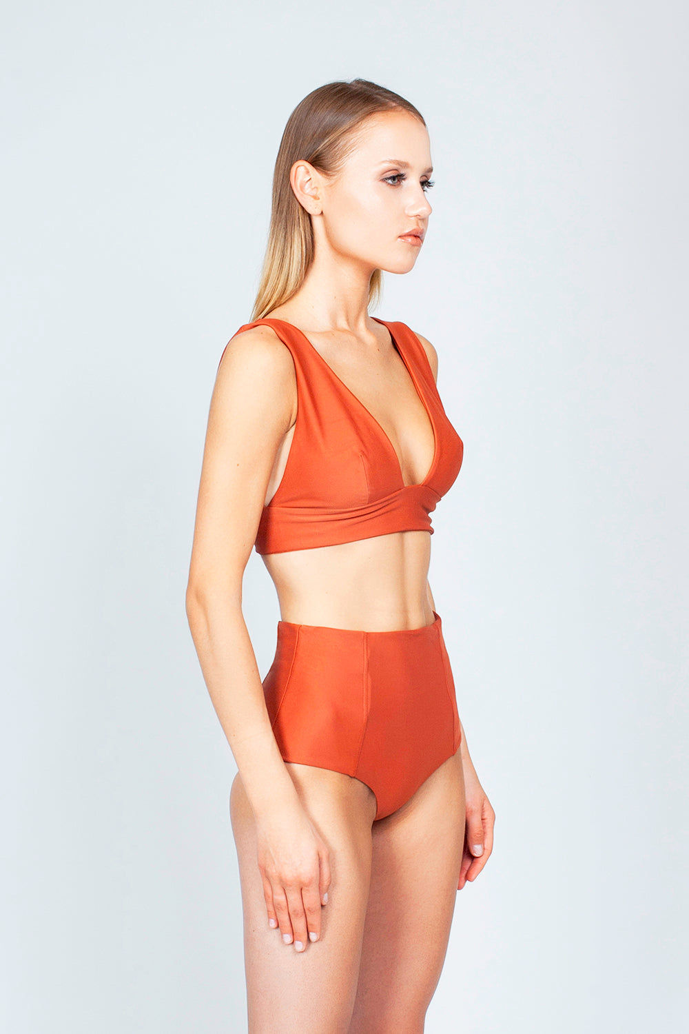 THE ONES WHO Dive Long Triangle Bikini Top - Copper Orange Bikini Top   Copper Orange  The Ones Who Dive Long Triangle Bikini Top - Copper Orange Long triangle top  V neckline  Thick bra band  V Back  Pull over  Made in LA  Fabric: 80% Nylon 20% Elastane Side View