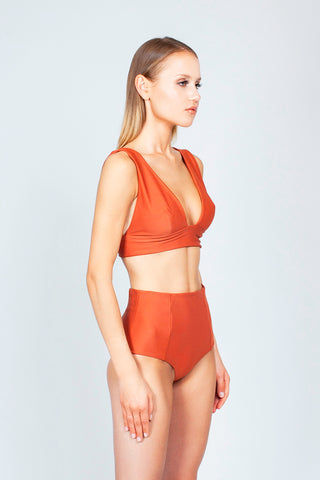 THE ONES WHO Heather High Waist Bikini Bottom - Copper Orange Bikini Bottom | Copper Orange| The Ones Who Heather High Waist Bikini Bottom - Copper Orange High waist Panel seams  Cheeky to moderate coverage Fully lined Made in LA  Fabric: 80% Nylon 20% Elastane Side View