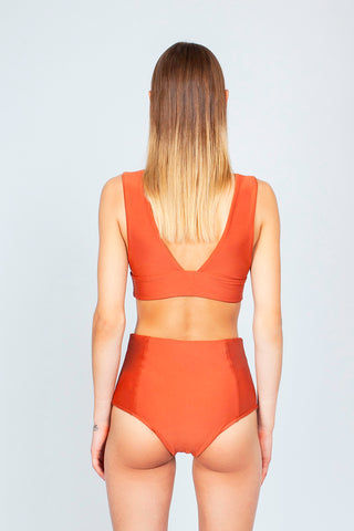 THE ONES WHO Dive Long Triangle Bikini Top - Copper Orange Bikini Top | Copper Orange| The Ones Who Dive Long Triangle Bikini Top - Copper Orange Long triangle top  V neckline  Thick bra band  V Back  Pull over  Made in LA  Fabric: 80% Nylon 20% Elastane Back View