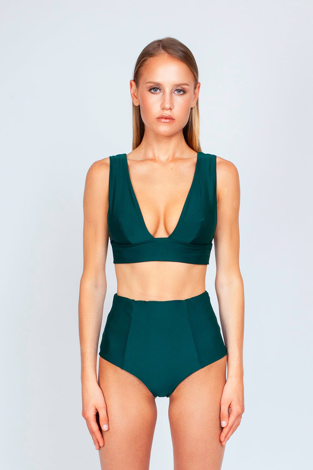 THE ONES WHO Dive Long Triangle Bikini Top - Emerald Green Bikini Top | Emerald Green| The Ones Who Dive Long Triangle Bikini Top - Emerald Green Long triangle top  V neckline  Thick bra band  V Back  Pull over  Made in LA  Fabric: 80% Nylon 20% Elastane Front View