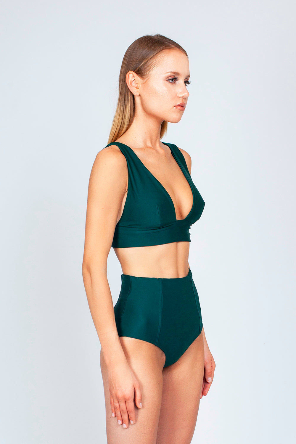 THE ONES WHO Dive Long Triangle Bikini Top - Emerald Green Bikini Top | Emerald Green| The Ones Who Dive Long Triangle Bikini Top - Emerald Green Long triangle top  V neckline  Thick bra band  V Back  Pull over  Made in LA  Fabric: 80% Nylon 20% Elastane Side View