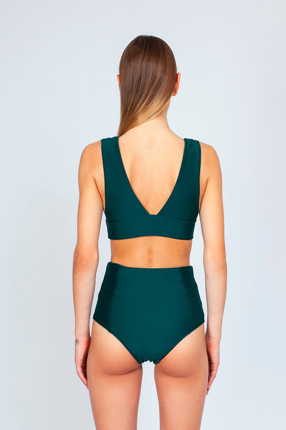 THE ONES WHO Dive Long Triangle Bikini Top - Emerald Green Bikini Top | Emerald Green| The Ones Who Dive Long Triangle Bikini Top - Emerald Green Long triangle top  V neckline  Thick bra band  V Back  Pull over  Made in LA  Fabric: 80% Nylon 20% Elastane Back View