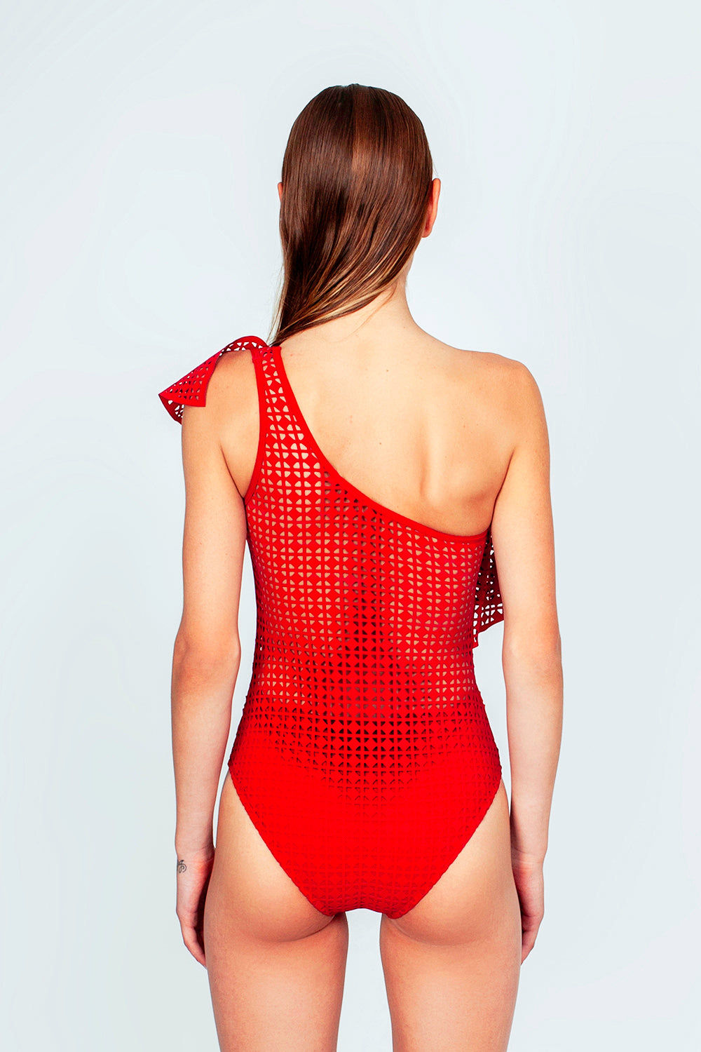 EVARAE Irene One Shoulder Laser-Cut One Piece Swimsuit - Red Matte One Piece | Red Matte| Evarae Irene One Shoulder Laser One Piece Swimsuit - Red Matte. Features:  One shoulder one piece Ruffle details Cutout designs Cheeky coverage Side View