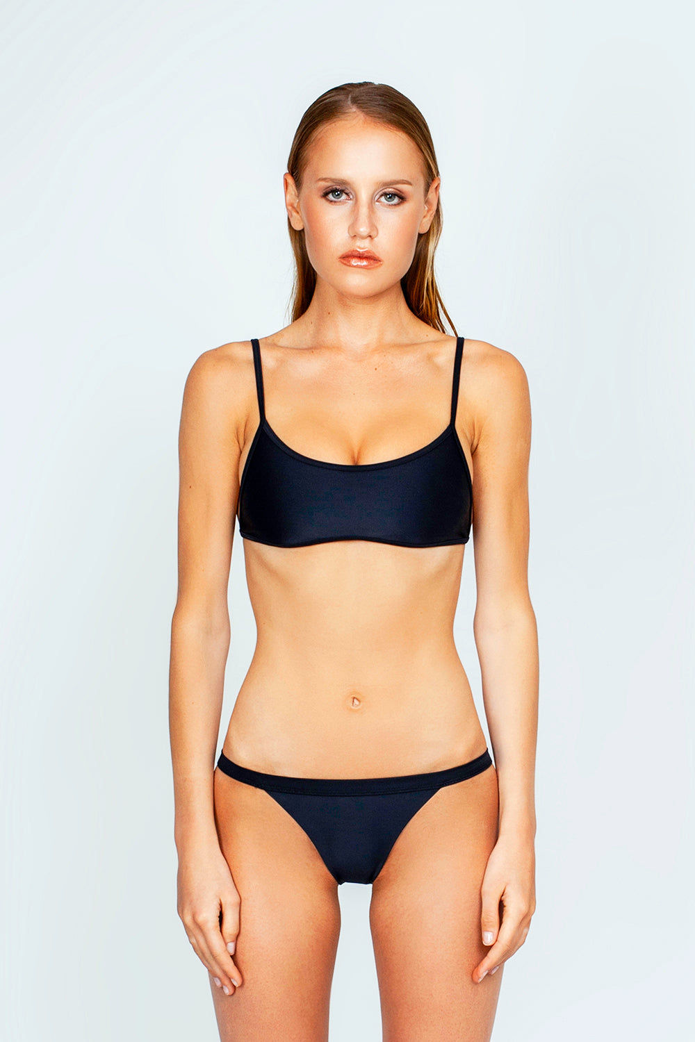 THE ONES WHO Ava Sporty Bikini Top - Black Bikini Top | Black| The Ones Who Ava Sporty Bikini Top - Black Sporty and minimal top Adjustable shoulder straps Self-tie back Fully lined with no cups Made in LA  Fabric: 80% Nylon 20% Elastane Front View