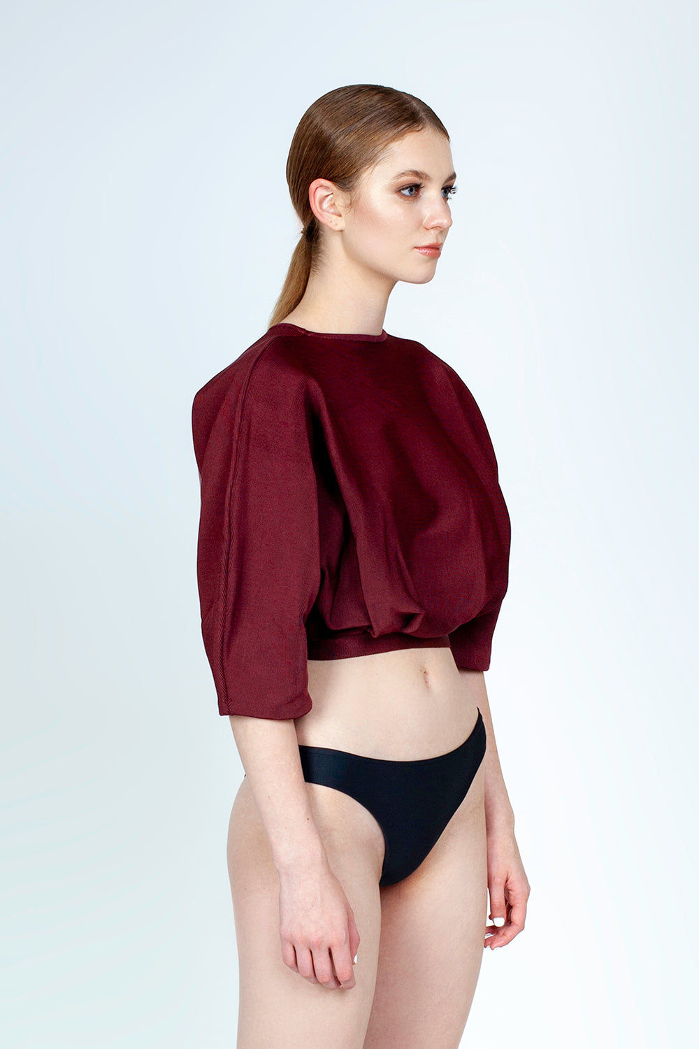 HAIGHT Inner Pleated Knit Top - Garnet Red Top | Garnet Red| Haight Inner Pleated Knit Bikini Top - Garnet Red Features:  Crew neckline  Sleeves to elbow length Pleated detail Side View