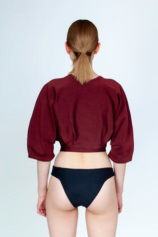 HAIGHT Inner Pleated Knit Top - Garnet Red Top | Garnet Red| Haight Inner Pleated Knit Bikini Top - Garnet Red Features:  Crew neckline  Sleeves to elbow length Pleated detail Back View