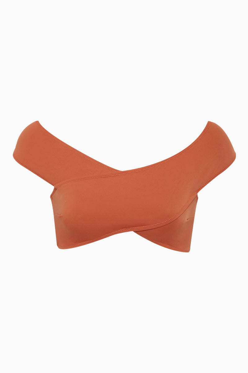 OYE SWIMWEAR Lucette Off Shoulder Criss Cross Bikini Top - Coral Orange Bikini Top | Coral Orange| Lucette Off Shoulder Criss Cross Bikini Top - Coral Orange Features: Figure-shaping statement bikini top. Criss-cross off-the-shoulder design sculpts curves while supporting larger breasts. Criss-cross lace up side detail.  Suitable for D and DD cup sizes. Deep red color is perfect for every skin tone. Coral-peach color is best with warm skin tones. Pair with adjustable Lucette bikini bottom to form the perfect hourglass figure. Add a sheer high-waisted skirt for beach-to-bar style. Front View
