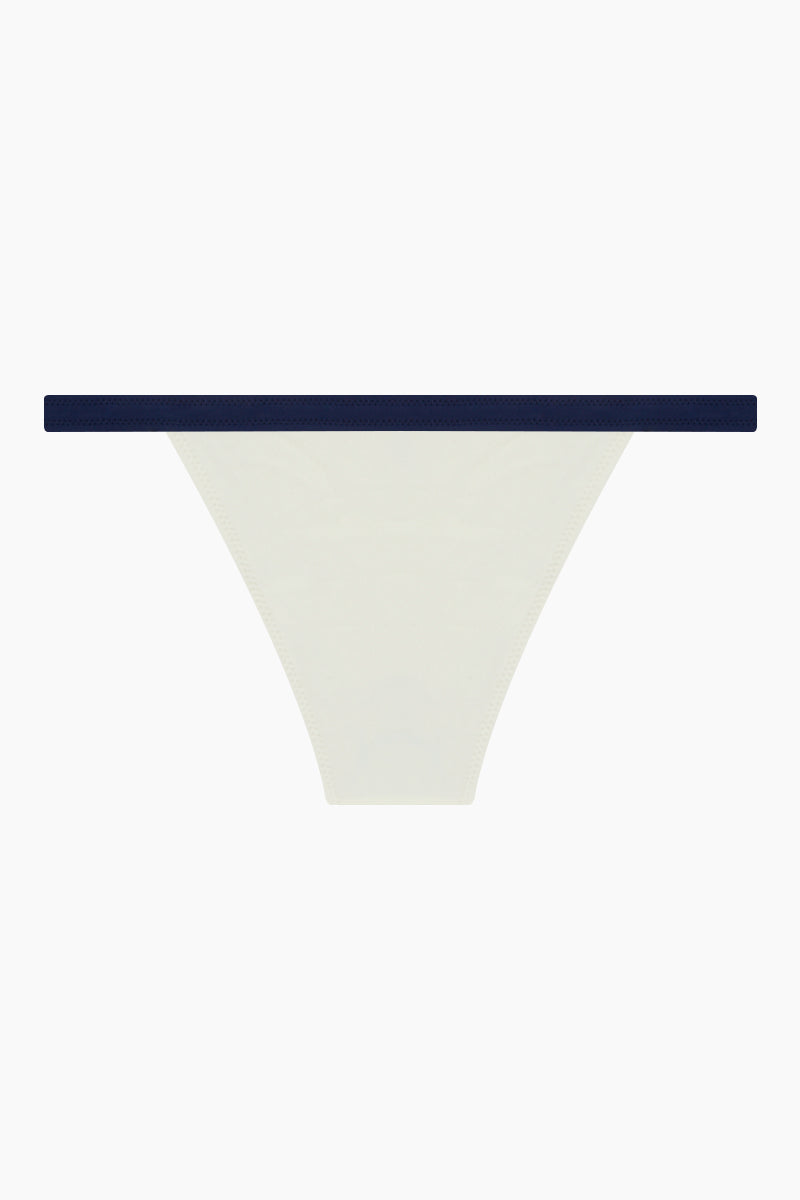 SOLID & STRIPED The Molly Brief Bikini Bottom - Cream/Navy Bikini Bottom | Cream/Navy| Solid & Striped The Molly Brief Bikini Bottom - Cream/Navy  Mid-rise white bikini bottom with color-blocked navy blue detail. Thin banded  Moderate coverage Back View