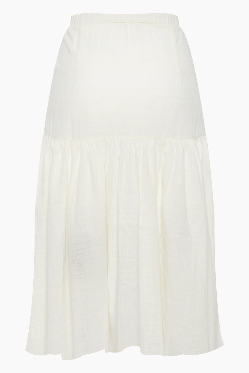 CLUBE BOSSA Fara High Waist Midi Skirt - Off White Skirt | Off White| Clube Bossa Fara High Waist Midi Skirt - Off White Midi skirt High waist Front tie closure Front button closure Ruffle side detail Back View