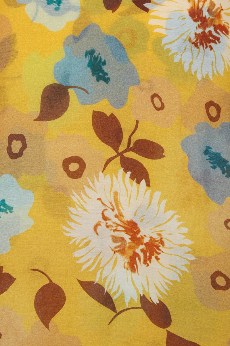 CLUBE BOSSA Sania Hi Lo Skirt - Cristal La Beija Floral Print Skirt | Cristal La Beija Floral Print| Clube Bossa Sania Hi Lo Skirt - Cristal La Beija Floral Print. Features:  High rise skirt Yellow floral print Mid-length Ruffle details Detail View