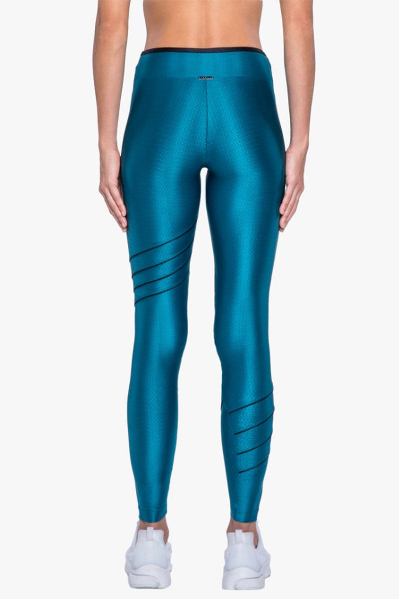 KORAL Illicit High Rise Legging - Calypso Leggings |  Calypso| Koral Illicit High Rise Legging - Calypso. Features:  High Rise Leggings  Piping Side Detail  Made in USA Back View