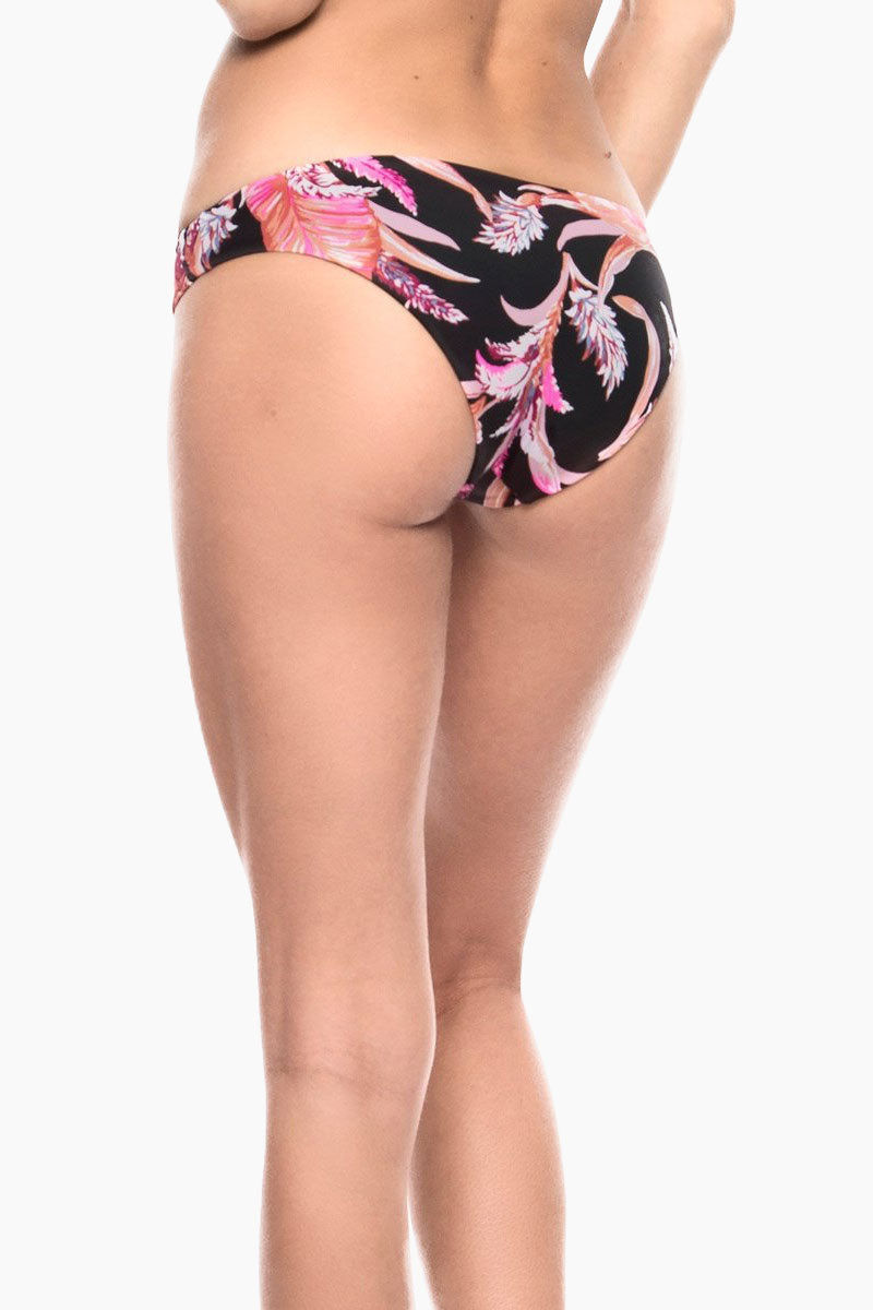 TORI PRAVER Isla Classic Bikini Bottom - Black Floral Bikini Bottom | Black Floral| Tori Praver Isla Classic Bikini Bottom - Black Floral Thick Sides Moderate Coverage Clean Finish / Solid Self Lining 80% Nylon / 20% Spandex Made In Sri Lanka Hand Wash With Love / Dry Flat In ShadeClose Up Back View