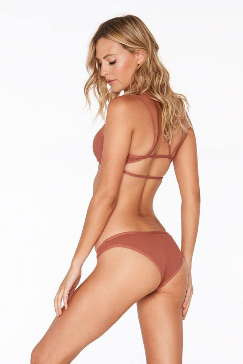 L SPACE Cosmo Bottom - Faded Rose Bikini Bottom | Faded Rose| L Space Cosmo Bottom Terracotta bikini bottom. Low rise cut. Ribbed texture fabric. Cheeky to moderate coverage.