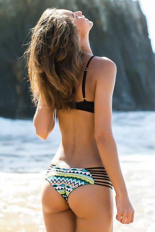 ISSA DE' MAR Sunset Reversible Strappy Ruched Bikini Bottom - Black/Geometric Tribal Print Bikini Bottom | Black/Geometric Tribal Print| Issa de' Mar Sunset Reversible Strappy Ruched Bikini Bottom - Black/Geometric Tribal Print Strappy side detail consisting of multi bands create a sexy, yet functional suit that is perfect for sun, swim, surf and poolside tanning. Reverses from a multi colored geometric print into an easy, classic black Back View
