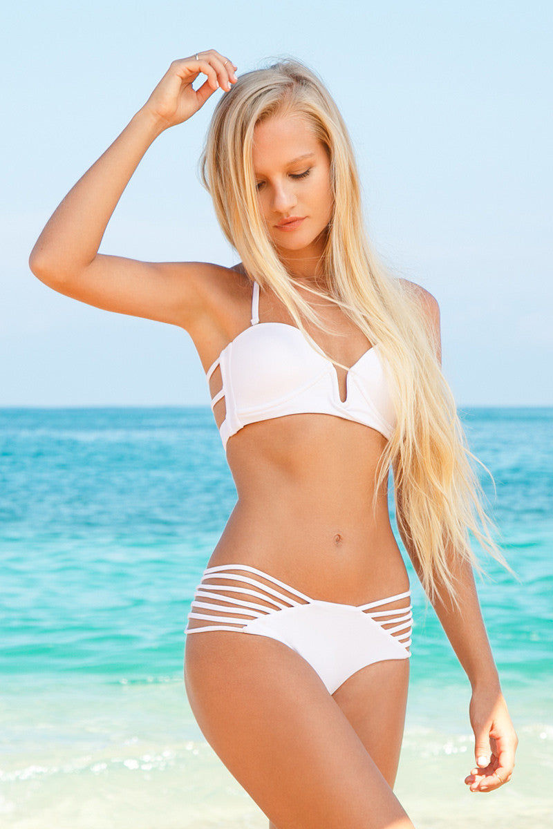 ISSA DE' MAR Sunset Strappy Ruched Bikini Bottom - White Bikini Bottom | White| Issa de Mar Sunset Strappy Ruched Bikini Bottom - White Seamless Strappy side detail Brazilian coverage Ruched detail 80% Nylon, 20% Spandex Front View