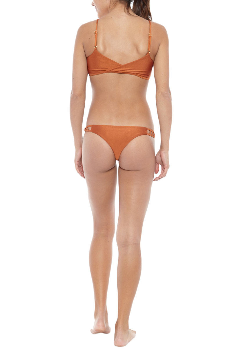 ISSA DE' MAR Hina Side Cut Out Cheeky Bikini Bottom - Copper Orange Bikini Bottom | Copper Orange| Issa De Mar Hina Side Cut Out Cheeky Bikini Bottom - Copper Orange Cheeky coverage bikini bottom in a Copper hue shows off your best assets. Seamless and hardware-free, this bikini bottom is perfect for all-day, fuss-free wear. Wide side straps hug your curves while peek-a-boo caged cut-outs Front View