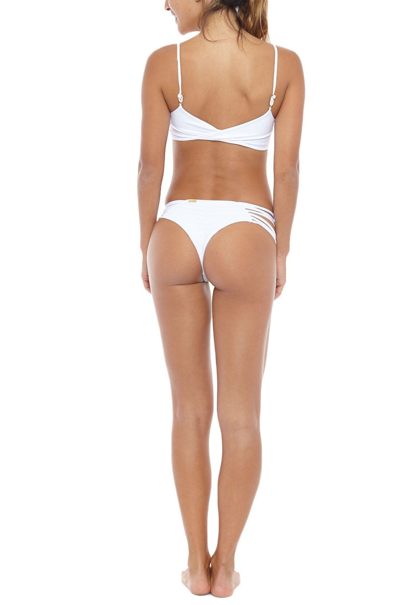 ISSA DE' MAR Hina Caged Strappy Bralette Bikini Top - White Bikini Top | White| Issa De Mar Hina Caged Strappy Bralette Bikini Top - White A classic white bikini top with cage front detail is a swimsuit wardrobe staple that pairs perfectly with a fun floral or on-trend animal print bottom. Pull over style with criss-cross back surplus detail . Deep v neckline Back View
