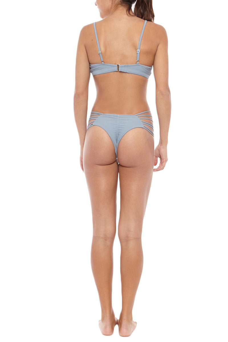 ISSA DE' MAR Sunset Strappy Ruched Bikini Bottom - Dusk Blue Bikini Bottom | Dusk Blue| Issa De Mar Sunset Strappy Ruched Bikini Bottom - Dusk Blue Strappy side detail consisting of multi bands create a sexy, yet functional suit that is perfect for sun, swim, surf and poolside tanning. Brazilian Cut backside shows off your curves and accentuates your best assets. Ruched detail Back View