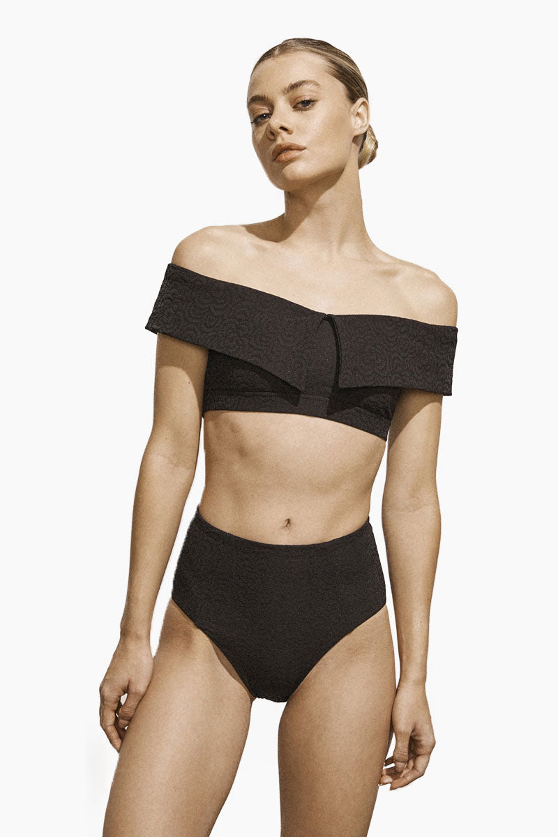 AMAIO SWIM Jolie Off The Shoulder Bikini Top - Black Bikini Top | Black| Amaio Swim Jolie Off The Shoulder Bikini Top - Black.  Features:  Luxe Jacquard fabric Unique fabric and fit Metal clasp at back Perfectly drapes to the female form Imported from France. View: Front view, on model.