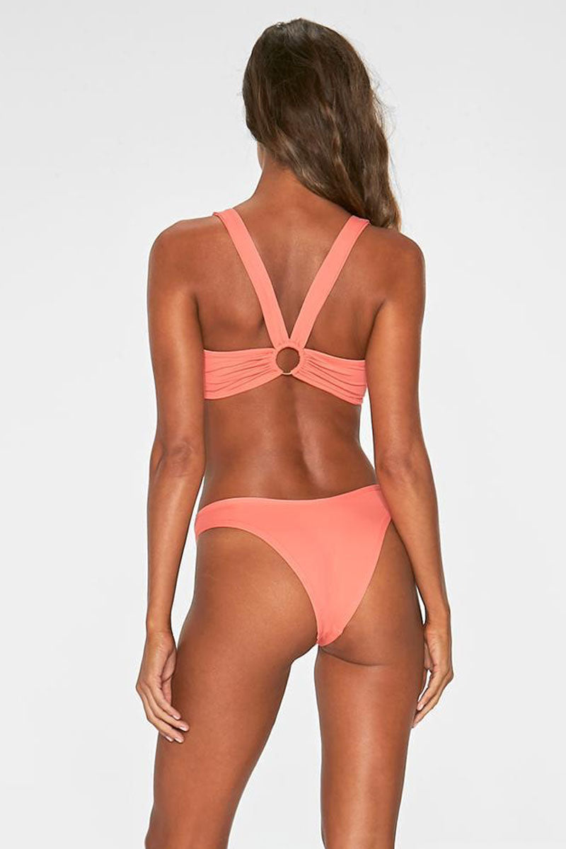 "L SPACE Julia Bikini Top - Neon Pink Bikini Top | Neon Pink| L Space Julia Bikini Top Front View Neon Pink Sporty Bikini Top Square Neckline ""O"" Hardware Detail at Center Front and Back Wide Shoulder Straps V-Cut Back Made in USA 80% Nylon 20% Spandex"