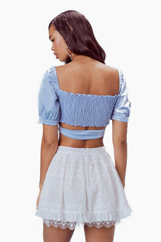 FOR LOVE AND LEMONS Juniper Cotton Wrap Top - Periwinkle Top | Periwinkle|For Love And Lemons Juniper Cotton Wrap Top - Periwinkle Features:  Adjustable Wrap Top Smocking at Back Puff Sleeves with Tie Detail Partially Lined Dry Clean Only Self: 97% Cotton/3% Spandex; Lining: 100% Polyester Back View