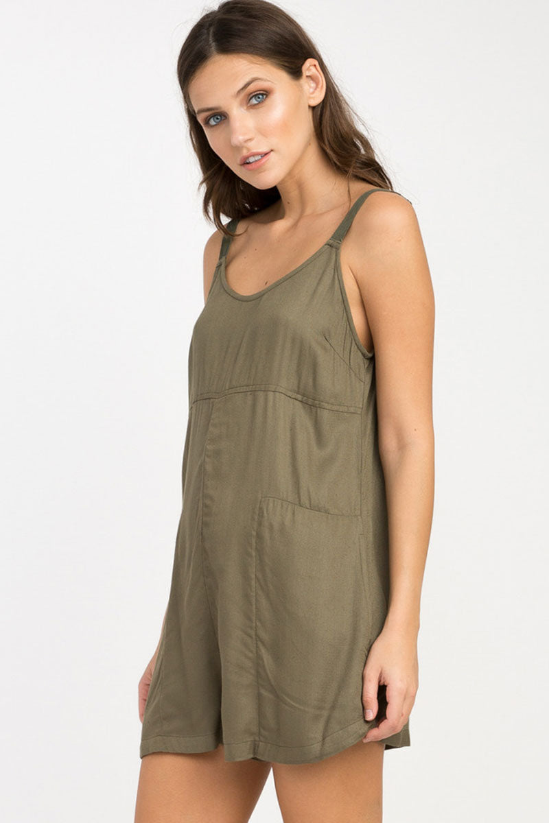 RVCA Jurys Out Romper - Burnt Olive Romper | Burnt Olive| RVCA Jurys Out Romper - Burnt Olive Short romper with on seam pockets Low scoop back Adjustable twill shoulder straps with metal strap adjusters 100% rayon Side View