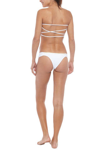 KOVEY Ripple Daisy Trim Strappy Bandeau Bikini Top - White Daisy Bikini Top | White Daisy| Kovey Ripple Daisy Trim Strappy Bandeau Bikini Top - White Daisy * Sweetheart neck strapless convertible bandeau bikini top in classic white. * Delicate daisy appliqués along the edges. Removable halter strap. Boning at the sides * Removable pads. * The criss-cross strappy back  Back View