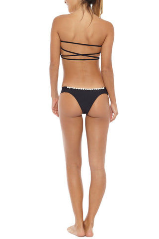 KOVEY Jetty Daisy Trim Ruched Sides Bikini Bottom - Black Daisy Bikini Bottom | Black Daisy| Kovey Jetty Daisy Trim Ruched Sides Bikini Bottom - Black Daisy Low-rise ruched sides hipster style cheeky bikini bottom in classic black. Delicate daisy appliqués along the edges make this bikini top a must-have for any bohemian beach babe. The wide side straps Back View