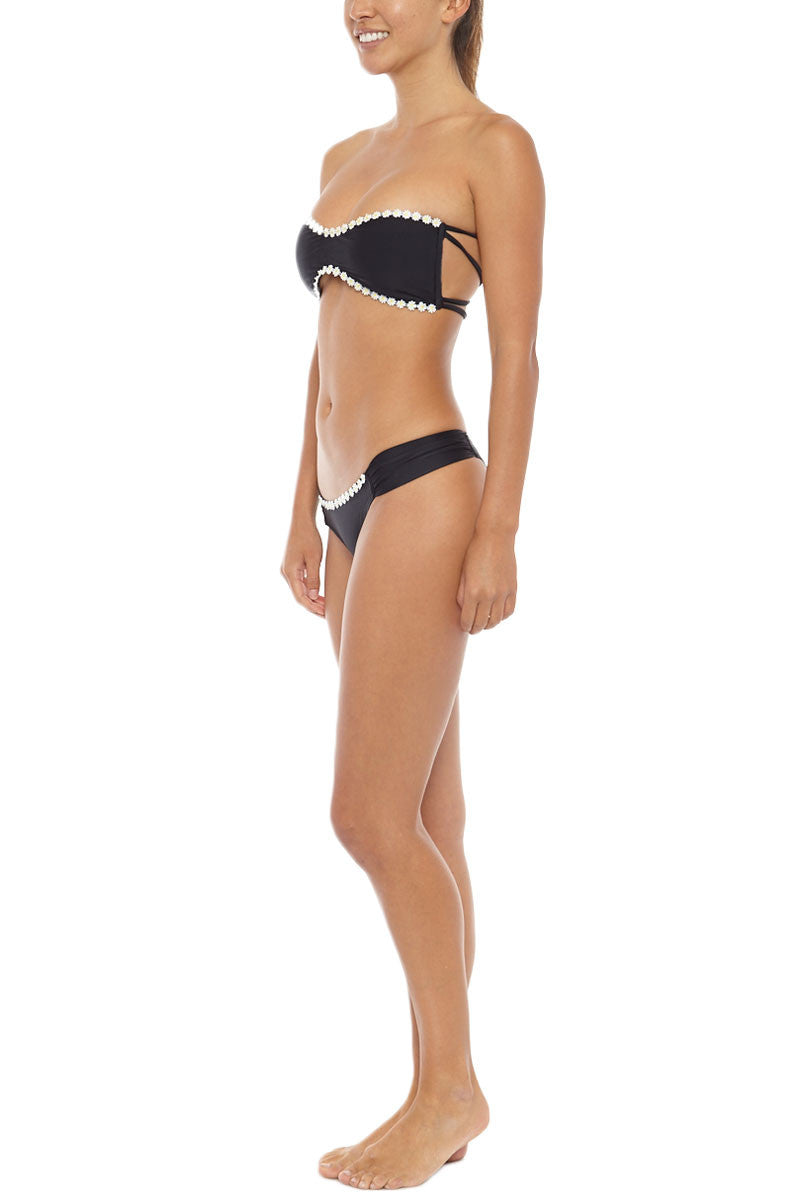 KOVEY Ripple Daisy Trim Strappy Bandeau Bikini Top - Black Daisy Bikini Top | Black Daisy| Kovey Ripple Daisy Trim Strappy Bandeau Bikini Top - Black Daisy * Sweetheart neck strapless convertible bandeau bikini top in classic black. * Delicate daisy appliqués along the edges. Removable halter strap. Boning at the sides * Removable pads. * The criss-cross strappy back Side View