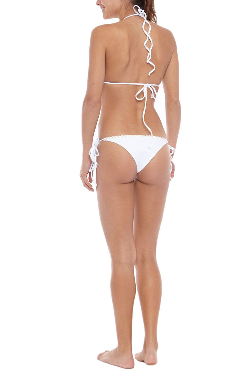 KOVEY Floater Daisy Trim Tie Side Bikini Bottom - White Daisy Bikini Bottom | White Daisy| Kovey Floater Daisy Trim Tie Side Bikini Bottom - White Daisy Low-rise side tie floral embellished cheeky bikini bottom in bright white. Delicate daisy appliqués along the edges make this bikini top a must-have for any bohemian beach babe. The adjustable ties Back View