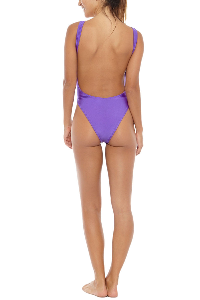 KOVEY Surfari Day High Cut One Piece Swimsuit - Electric Purple One Piece | Electric Purple| Kovey Surfari Day High Cut One Piece Swimsuit - Electric Purple * 80s inspired V-neck high cut one piece swimsuit in electric purple. * Deep V-neckline and sultry open back expose skin while flattering your figure. * The trending high-cut  * Wide, fixed shoulder straps offer extra bust scheeky coverage. Back View