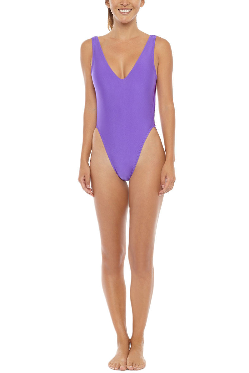 KOVEY Surfari Day High Cut One Piece Swimsuit - Electric Purple One Piece | Electric Purple| Kovey Surfari Day High Cut One Piece Swimsuit - Electric Purple * 80s inspired V-neck high cut one piece swimsuit in electric purple. * Deep V-neckline and sultry open back expose skin while flattering your figure. * The trending high-cut  * Wide, fixed shoulder straps offer extra bust scheeky coverage. Front View