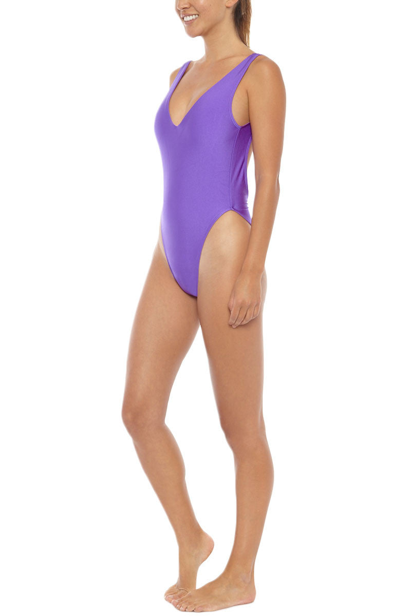 KOVEY Surfari Day High Cut One Piece Swimsuit - Electric Purple One Piece | Electric Purple| Kovey Surfari Day High Cut One Piece Swimsuit - Electric Purple * 80s inspired V-neck high cut one piece swimsuit in electric purple. * Deep V-neckline and sultry open back expose skin while flattering your figure. * The trending high-cut  * Wide, fixed shoulder straps offer extra bust scheeky coverage. Side View