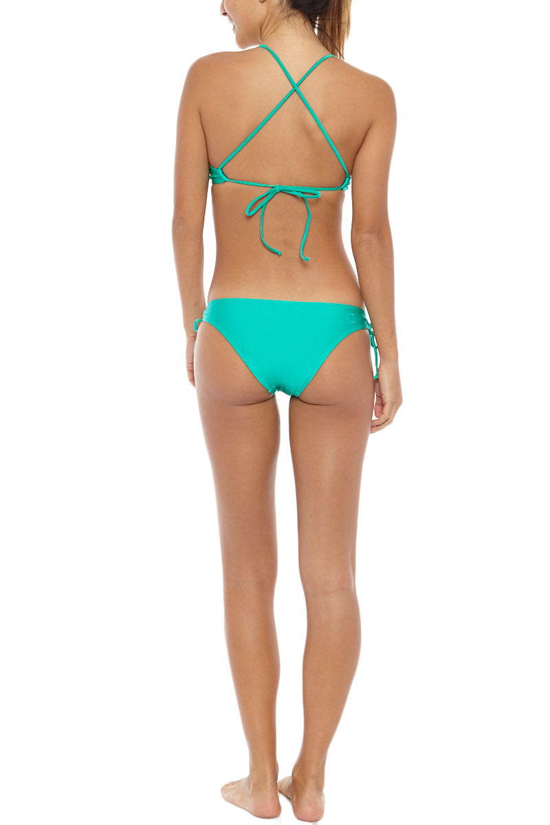 KOVEY Swell Criss Cross Back Bralette Bikini Top - Sea Green Bikini Top | Sea Green| Kovey Swell Criss Cross Back Bralette Bikini Top - Sea Green Sporty scoop neck strappy back bikini top in vibrant sea green. Stretch-fit fabric features a hint of sheen for a brilliant glow in the sunshine. Removable pads allow you to wear this bikini top as a bralette, or with extra padding for smoothing and shaping. The thin spaghetti straps Back View