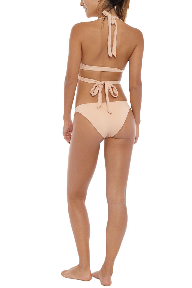 KORE Maia Low Rise Bikini Bottom - Nude Bikini Bottom | Nude| KORE Maia Low Rise Bikini Bottom - Nude Low rise cheeky bikini bottom in neutral beige. Wide, hardware-free side straps stay secure for worry-free swimming and sunbathing. Easy pull-on style crafted from stretch-fit fabric for the most comfortable fit. Moderate rear cut shows off your curves while providing cheeky coverage. Back View