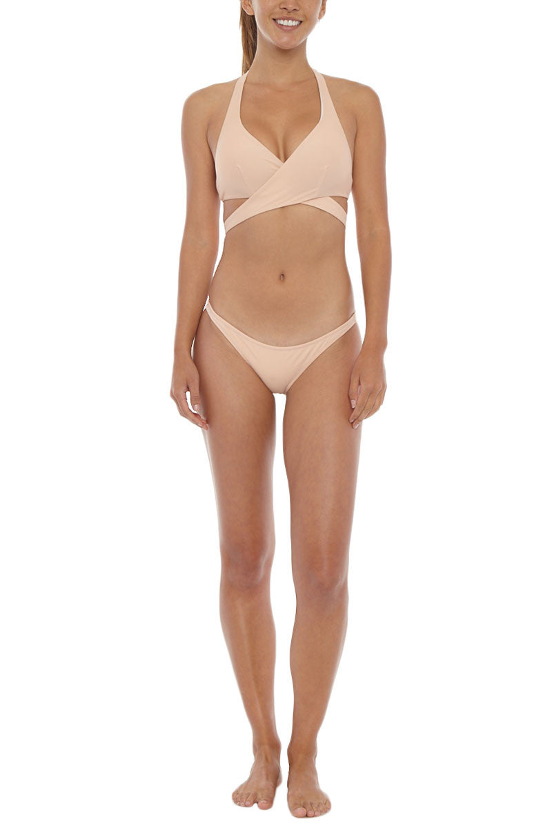 KORE Maia Low Rise Bikini Bottom - Nude Bikini Bottom | Nude| KORE Maia Low Rise Bikini Bottom - Nude Low rise cheeky bikini bottom in neutral beige. Wide, hardware-free side straps stay secure for worry-free swimming and sunbathing. Easy pull-on style crafted from stretch-fit fabric for the most comfortable fit. Moderate rear cut shows off your curves while providing cheeky coverage. Front View