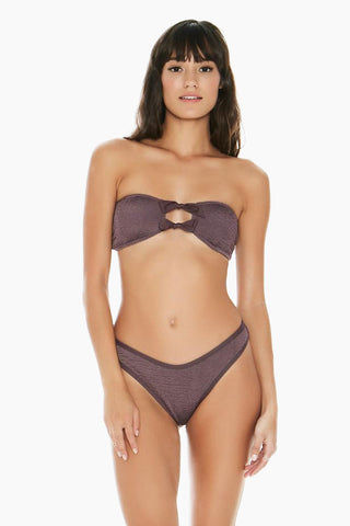 L SPACE Kristen Bandeau Bikini Top - Pebble Bikini Top |  Pebble| L Space Kristen Bandeau Bikini Top - Pebble. Pull-over style bandeau Double bows at center Keyhole detail Pucker texture fabric Removable pads 93% poly, 7% spandex Like all delicates, shape, color and fit are best preserved if hand washed in cold water. Lay flat to dry. Front View