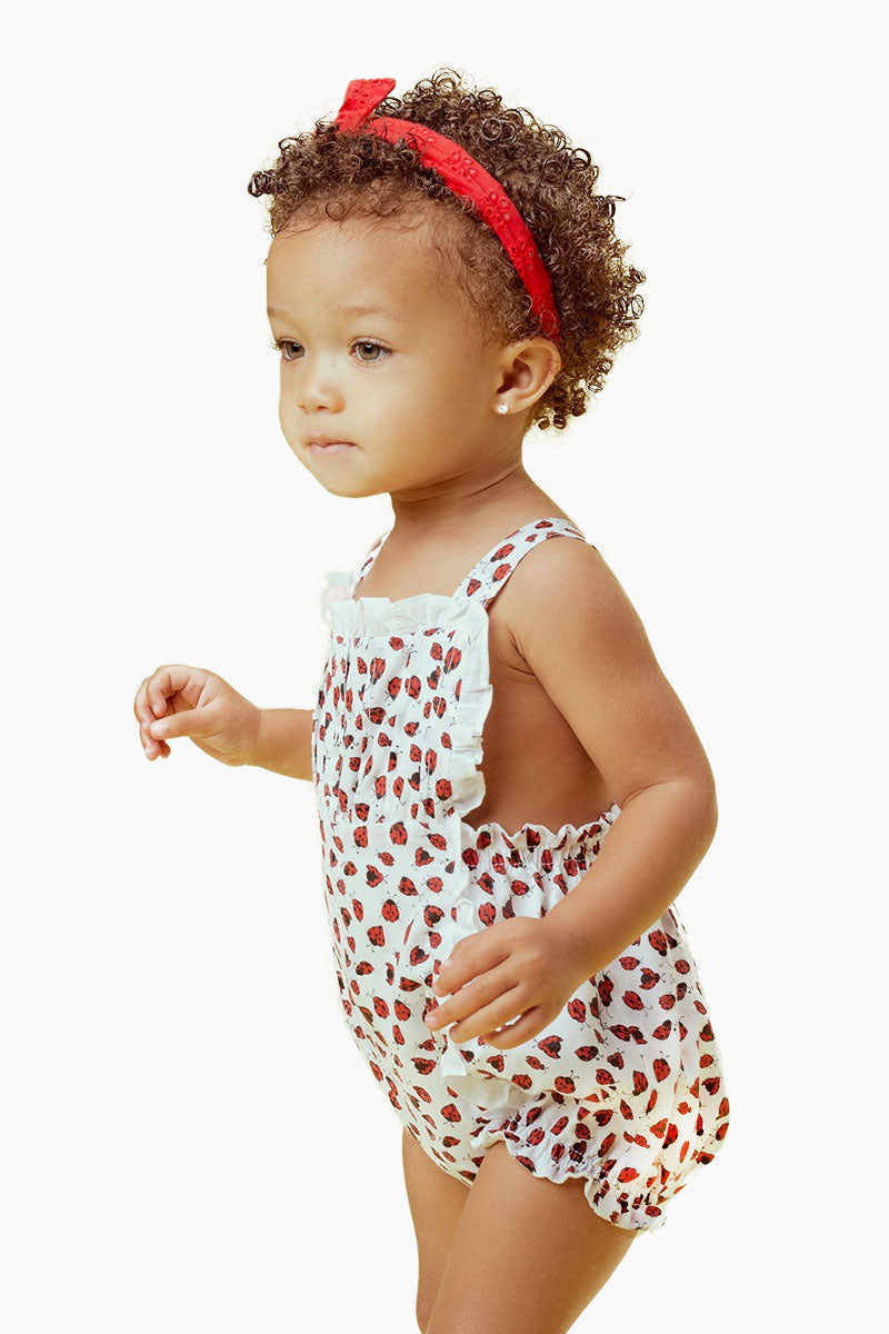 LIL LEMONS Ladybug Romper (Kids) - Ruby Kids Resort | Ruby| LIL LEMONS Ladybug Romper (Kids) - Ruby.Features:  Pin-tuck details Adjustable criss-cross straps Snap closure- making diaper changing quick and easy Front View