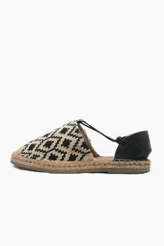 CHILA BAGS Lebron Lace Up Shoes - Black Print Shoes | Black Print| Chila Bags Lebron Lace Up Shoes - Black Print Closed toe shoes with black print black leather heel Made with natural leather Lace up wrap around straps Handcrafted in Colombia Front View