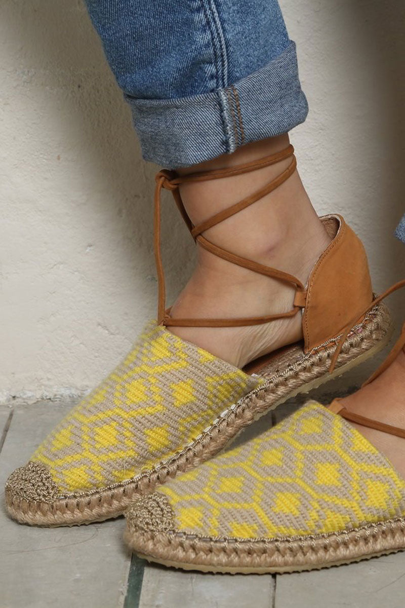 CHILA BAGS Lebron Lace Up Shoes - Yellow Print Shoes | Yellow Print|Chila Bags Lebron Lace Up Shoes - Yellow Print Closed toe shoes with yellow print Tan leather heel Made with natural leather Lace up wrap around straps Handcrafted in Colombia Front View