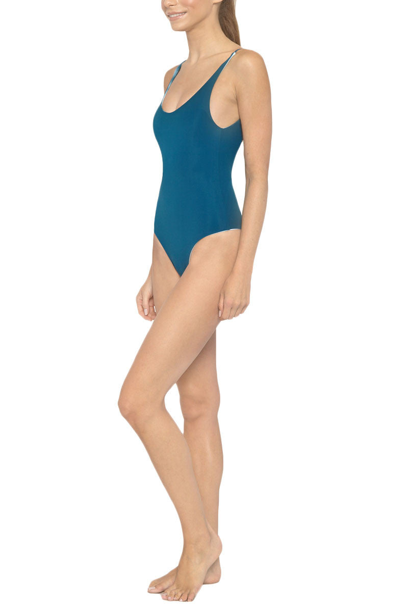LES COQUINES Kaila Reversible Scoop Back One Piece Swimsuit - Ocean Blue Tie Dye Print/Fiji Blue One Piece | Ocean Blue Tie Dye Print/Fiji Blue| Les Coquines Kaila Reversible Scoop Back One Piece Swimsuit - Ocean Blue Tie Dye Print/Fiji Blue Scoop neck open back reversible maillot style one piece swimsuit in a serene deep blue ocean print. Fully reversible to deep teal Side View