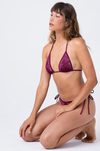 INDAH Lewis Lace Tie Side Bikini Bottom - Bordeaux Wine Red Bikini Bottom | Bordeaux Wine Red| Indah Lewis Lace Tie Side Bikini Bottom - Bordeaux Wine Red Features:  Tie Side Bottom  High Cut Leg  Thong Coverage  Lace Detail Front View