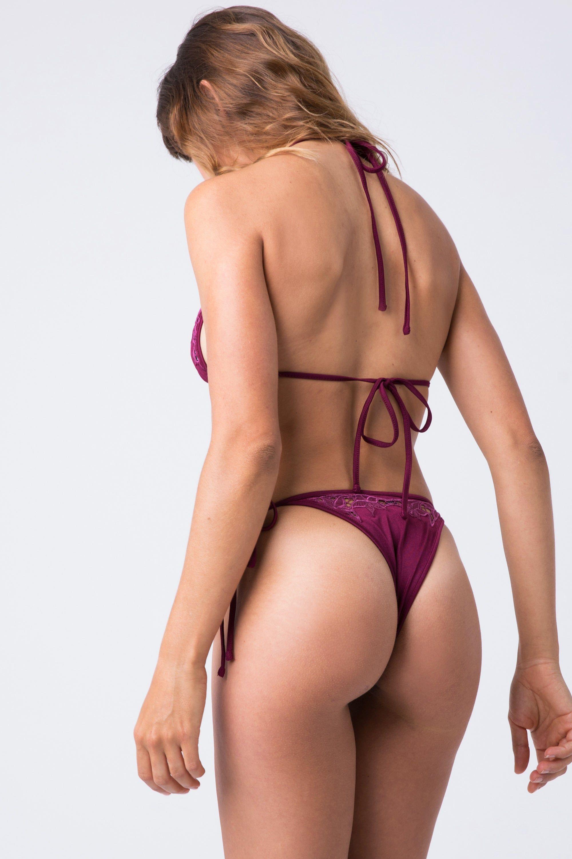 INDAH Lewis Lace Tie Side Bikini Bottom - Bordeaux Bikini Bottom | Bordeaux| Indah Lewis Lace Tie Side Bikini Bottom - Bordeaux Features:  Tie Side Bottom  High Cut Leg  Thong Coverage  Lace Detail Back View