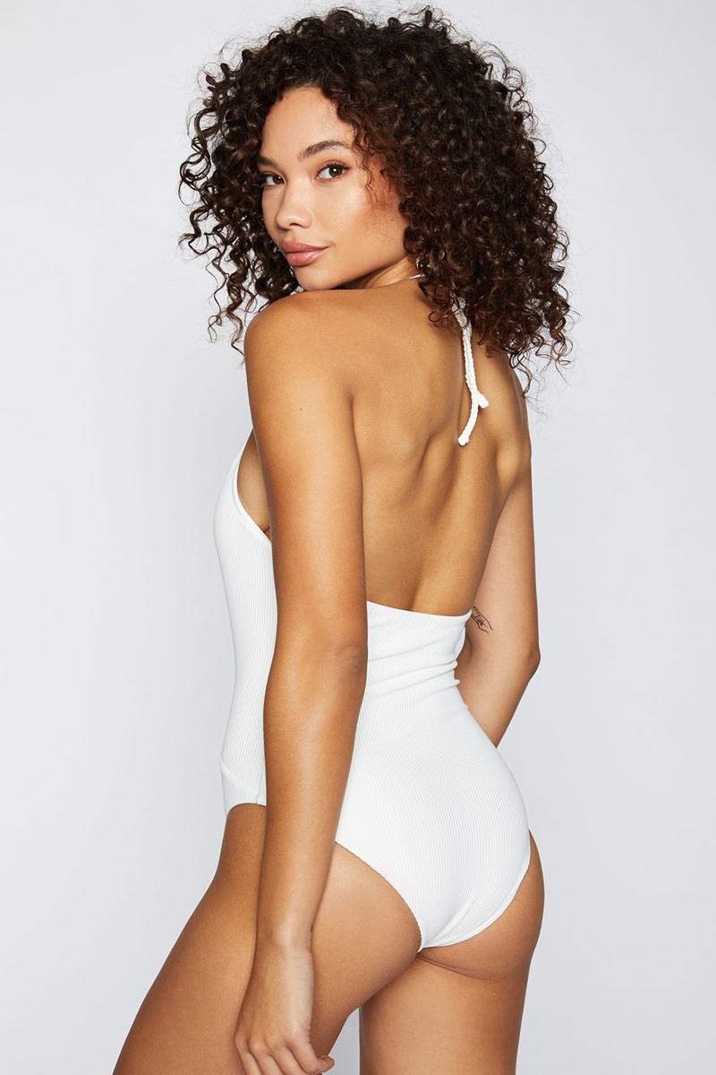 FRANKIES BIKINIS Lily One Piece - White One Piece | White|Lily One Piece - Features:  Plunge deep v-neck one piece White ribbed fabric Halter neck string tie Moderate coverage bottom
