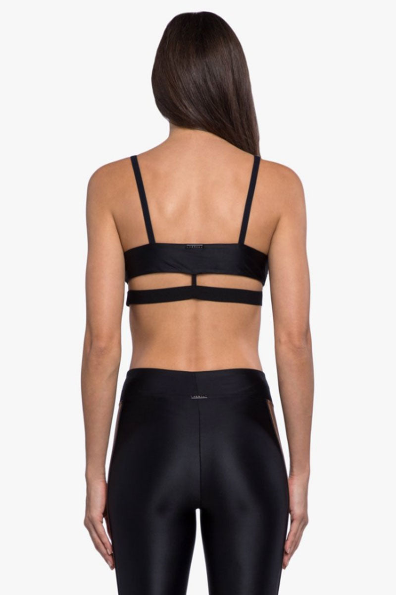 "KORAL Limerence Infinity Sports Bra - Black/Toffee/Egret Activewear | Black/Toffee/Egret| Koral Limerence Infinity Sports Bra - Black/Toffee/Egret. Features:  V-neck Moderate coverage and support Medium Performance Color Absolute anti-fade technology Model wearing size S  Model Measurements: Height 5' 9"", Waist 24"", Bust 32"", Hips 34"" Fabric 1: Infinity - 85% Polyamide, 15% Xtra Life Lycra Sport Fabric 2: Netz - 89% Polyamide, 11% Lycra Fabric 3: Energy - 74% Nylon, 26% Spandex Lining: Power Mesh - 72% Nylon, 28% Elastance Made in the U.S. Back View"
