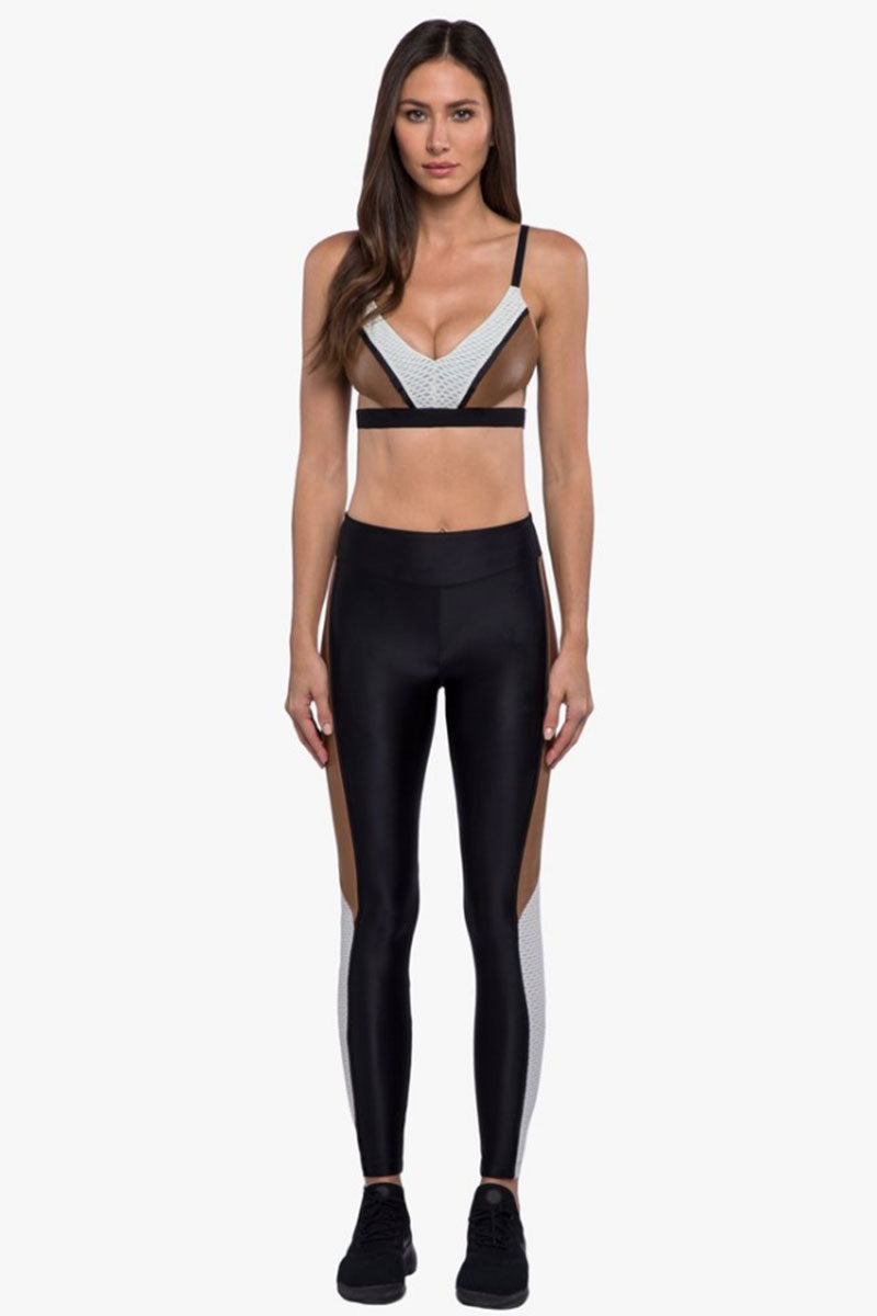 KORAL Limerence Color Block Infinity Sports Bra - Black/Toffee Brown/Egret White Activewear | Black/Toffee Brown/Egret White| Koral Limerence Color Block Infinity Sports Bra - Black/Toffee Brown/Egret White  Features:  V-neck Moderate coverage and support Medium Performance Color Absolute anti-fade technology Model wearing  Made in the U.S. Front View